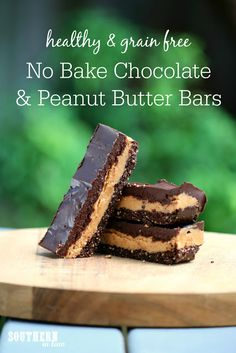 This Healthy No Bake Chocolate and Peanut Butter Bars Recipe is a healthy treat that tastes like Reese's Peanut Butter Cups. Grain free, paleo and peanut free option, raw, gluten free, vegan, refined sugar free and a clean eating recipe, this is the perfect healthy alternative to your favourite candy bars. A chocolate cookie like base is topped with a creamy peanut butter filling and delicious coconut oil chocolate topping - all made with only 5 ingredients!