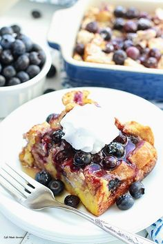 Overnight Blueberry Cream Cheese French Toast Bake - Super easy & delicious baked French Toast bursting with bursting with blueberries,cream cheese, brown sugar streusel and the BEST blueberry sauce. Make it the night before and pop it in the oven in the morning. French toast roll-ups would also be a great option!