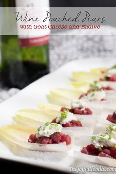 Spiced, wine poached pears with tangy, herbed goat cheese served over crisp endive - an easy and impressive appetizer or hors d'oeuvre.