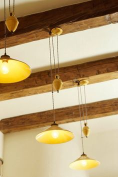 Create a well-lit basement using track lighting, recessed lighting, and other lighting fixtures. Low Ceiling Lighting, Ceiling Beams, Ceiling Fixtures, Home Lighting, Track Lighting, Pendant Lighting, Lighting Ideas, Beam Ceilings, Pendant Lamps