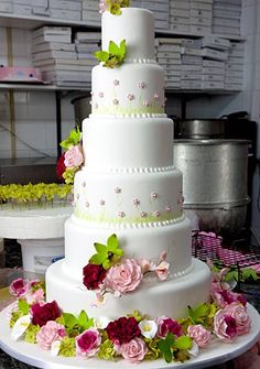 i DO NOT want a cake this tall and i don't like the shade of green they chose. but i do like the peonies and roses and little tiny flowers