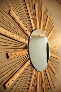 awesome wall art made from kabob sticks, a nice mirror, rulers and a your fave heavy duty glue. by tonya