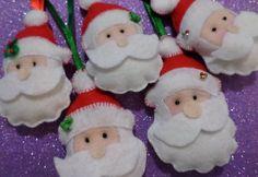 Lindos bonequinhos de feltro todos costurados a mão para lembrancinhas e enfeites de árvore de natal ou pingente de porta.    Medem em torno de 8 a 12cm de altura.    Consulte para encomendar outros modelos, cores e tamanhos.