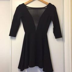 black American apparel dress Black American apparel dress! Size small. Mesh in front with an open back. 3/4 length sleeves American Apparel Dresses