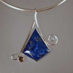 Pendant of lapis lazuli and smoky topaz set in sterling silver. from Johnson Metal Arts