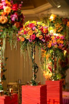 Ceremony Decor - vibrant tall arrangements - pink and orange wedding flowers Wedding Arrangements, Wedding Table Centerpieces, Flower Centerpieces, Floral Arrangements, Tall Centerpiece, Orange Wedding Flowers, Floral Wedding, Wedding Colors, Purple Flowers