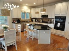 Dark and dreary kitchen gets DIY white painted cabinets, new pendant lighting, and updated trim (but on a budget!)  at 11 Magnolia Lane.  The finished product was featured in BH&G Kitchen+Bath Makeovers magazine, too.