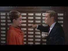 """A rather wonderful still from """"Breakfast at Tiffany's"""" filmed in front of a card catalog at the NY Public Library. From the click-through, """"13 Of The Best Library Scenes In Movies"""""""