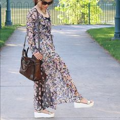 Floral Maxi dress This is a sheer maxi dress in a cute floral print. It comes with buttons so you can use it like a layer/kimono style, or use as is - a maxi dress! Just wear a slip or something underneath. :) should fit small to medium, sizes 2-6. Worn once for this photo shoot Dresses Maxi
