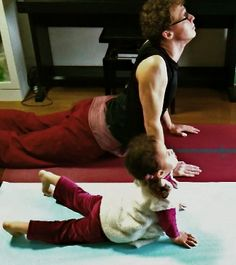 Maybe some day my daughter will do yoga with me, rather than attack me while I'm vulnerable on the floor :)