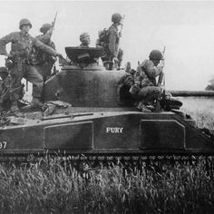 "The real Fury.  Some American soldiers are mounted on a Sherman Firefly tank , named ""Fury"". The Firefly tank was a detect response to the Tiger 1 tank which was a big threat to normal Sherman's. the only difference was the Firefly was equipped with a much more powerful 76mm gun. France 1944  Pc: @the_last_great_war"
