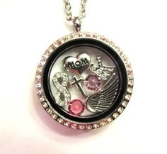 In Memory Of My Mom Floating Charm Locket  by LoveStoryCharms, $39.99  This locket includes an mom charm, angel wing, infinity charm, cross (currently only have rhinestone cross in stock), and your choice of initial, and their birth, and passing month stone.( please list stones, and initial in a note during checkout) Also includes a Stainless Chain Necklace.