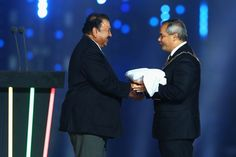 CGF president Prince Imran hands over the Commonwealth Games flag to Gold Coast City Mayor Tom Tate.
