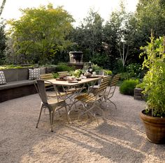 Alfresco Living - contemporary - patio - seattle - Scot Eckley Inc. patio table right on gravel. New plan for patio expansion - pea gravel!