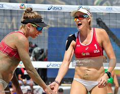 Team USA's April Ross and Kerri Walsh Jennings participate in the ASICS World Series of Volleyball on August 23, 2015 in Long Beach, California.