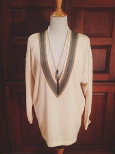 Deep v-neck ivory chunky vintage sweater. Perfect for fall :)