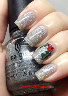 Silver bells and mistletoe  - silver glitter  polish background and a sprig of mistletoe
