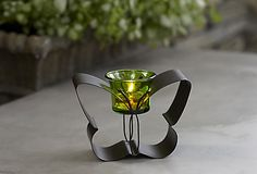 Flutter Votive Holder - Favorite fluttery friend glows with the soft light of a tealight or votive, sold separately. Weather-resistant, bronze-finished metal with glass votive cup. #PartyLite #candles