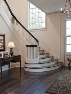 white staircase dark rail