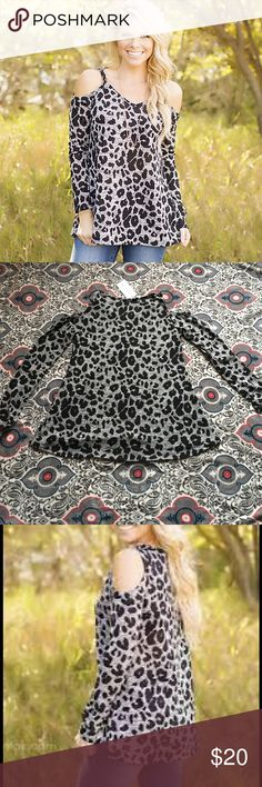 Leopard print long sleeve Gorgeous leopard print long sleeve light  sweater type shirt. It has cut out shoulders for a sexy look. Flaired at bottom. Brand new with tags. 93% polyester 7% spandex.  True to size. Filly Flair Tops