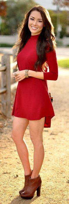 Adorable red summer mini dress with leather hand bag and braslate and brown leather high heels long boots the best way to show fashion & style