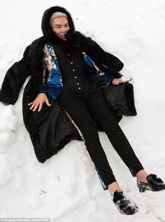 Having a ball: The cosmetic surgery enthusiast, 34, even attempted to make snow angels as ...