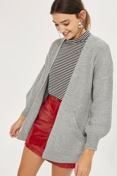 Wrap up this winter in this bang on-trend grey ribbed cardigan. An every day staple with belt detail to trap the heat, wear with a striped tee and a colour-pop A-line skirt for some cool simplicity with edge.