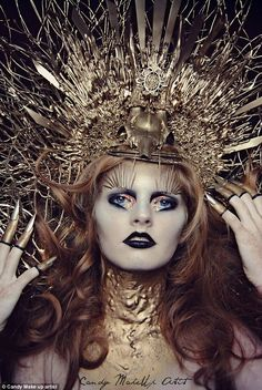This look includes a giant gold intricate head dress with matching nails and black lipstic...