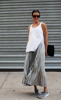 a  grey or silver pleated skirt with a white top, sneakers and you can go!