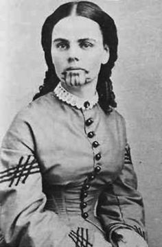 "Olive Oatman was ""the first white tattooed woman in the history of the United States..."" ~ Olive Oatman was 13 when she travelled from Illinois to California with her Mormon family. On the journey, the family were ambushed by a Native American tribe, who killed all but Olive, her Sister (who lated died of starvation) and her Brother (who escaped). After being sold to another tribe, as a slave, she was tattooed (tattoo) and taken in as ""one of their own"". She was 'rescued' 5 years later."