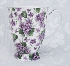 Clusters Of Wild Violets Cover This Gold Trimmed Bone China Mug
