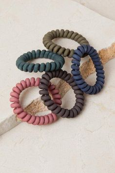 The Alexis Matte Hair Coil Set features a set of 5 hair coils in a matte finish. Scrunchies, Betty Cooper, Coil Hair Ties, Hair Supplies, Accesorios Casual, Hair Tie Bracelet, Cute Bracelets, Hair Accessories For Women, Cute Jewelry