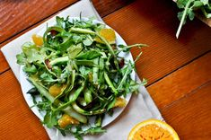 Shaved Asparagus Salad with Citrus and Arugula - skip the bacon and add some avocado and this is right up my alley!