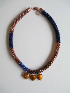 Crochet necklace with seed beads and heart pendants