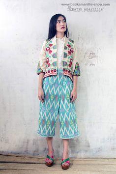 Batik Amarillis Made in Indonesia proudly presents :Batik Amarillis's Arcana jacket in Hungarian embroidery on natural, raw and beautiful Tenun gedog Tuban of Indonesia with tenun batik gedog Piping and Blogger wrap pants in Ikat Jepara of Indonesia.