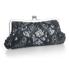 Our opulent 10 w x 4 12 h Pewter satin evening bag is adorned with Pewter & Hematite seed beads, bugle beads, sequins & Grey gems. This dressy beaded clutch purse with a silver frame & kiss clasp includes detachable silver wrist & shoulder chains. This gorgeous Pewter wholesale evening bag will accessorize any dark grey, charcoal, pewter or hematite dress for weddings, mothers of the brides, galas, b