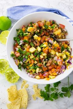 Pineapple Salsa in a Bowl with Lime and Tortilla Chips on the Side