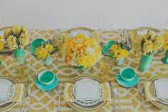lemon + mint table inspiration // teal glassware, teal vases, yellow flowers, yellow tablecloth