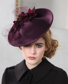 Jane Taylor Millinery, Queenie, A/W 2013 - Wool felt disc with handmade orchid flowers veiling detail.