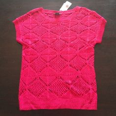 NWT Hot Pink Short Sleeve Sweater - Size S NWT hot pink short sleeve sweater - size Small. Open weave knit with buttons down the back. Perfect for spring! Lose, but flattering fit. Loved it so much I bought 4 of them!  Just too many of the same style so I'm letting go of this one. Rue 21 Tops