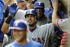 Texas Rangers' Geovany Soto is greeted in the dugout after he hit a two-run home run against the Seattle Mariners in the fourth inning of a baseball game, Sunday, Sept. 23, 2012, in Seattle. (AP Photo/Ted S. Warren)