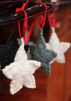 stars hanging  Pattern:  Knit Stars needles:  US #6 circular yarn:   Worsted Wool Ravelry Page