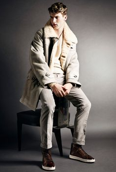 Tom Ford AW14 Menswear - Look 13 | Light beige Icelandic suede shearling parka.  Grey mélange brushed cashmere v-neck.  White mafile jersey garment dyed cotton v-neck t-shirt. Light grey cotton stretch needle cord sport pants.  Russel dark brown calfskin high-top tennis shoes.