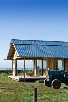 Contrast between rugged timeless tractor and contemporary stylish house.