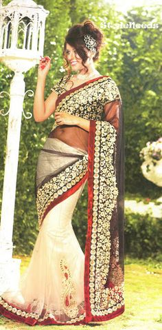 Party Wear Embroidered Saree cum lehanga paired with a matching heavy designer blouse.