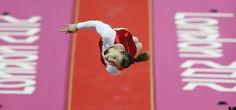 French gymnast Aurelie Malaussena performs on the vault during the artistic gymnastics women's individual all-around competition final at the 2012 Summer Olympics, Thursday, Aug. 2, 2012, in London.