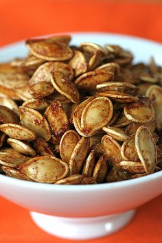 """Wondering what to do with all those pumpkin seeds that you scoop out?? Make these salty pie-spiced pumpkin seeds to munch on...yum!"""