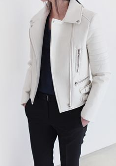 black tailored pants black vest white architectural jacket sippers pockets