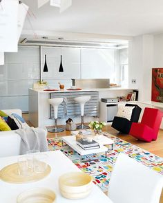 Spacious White Three Bedroom Apartment with Bold Splashes of Colour