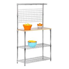 Metal and chrome baker's rack with maple cutting surface. Includes 2 adjustable wire shelves and spice rack.       Product: Bak...